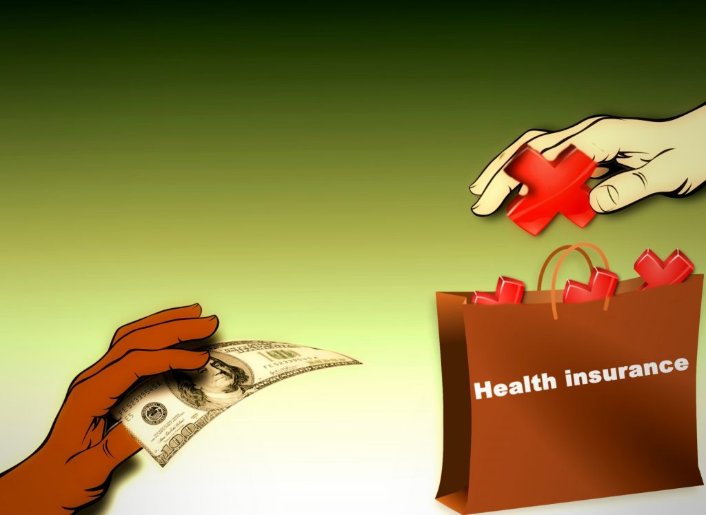 hand giving health insurance from bag to another hand holding hundred dollar bill