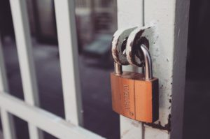 lock on a jail cell for nfl insurance fraud