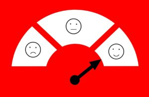 meter with faces on it going from sad to happy, with pointer on happy face