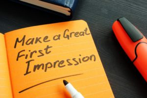 make a great first impression written on an orange notepad