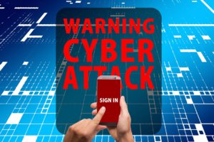 "a hand holding a cell phone with the words sign in on it and above the cell phone are the words ""warning cyber attack"" in large letters"