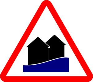 houses with water rising in a large red triangle sign