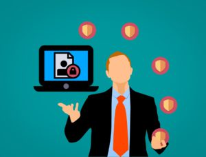 illustration of a person in a suit with a laptop and shields around it