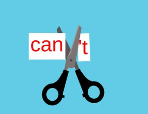 scissors cutting the T off the word can't