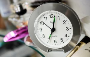 """clock with the time """"7:00"""" on it"""