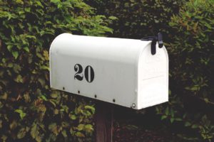 white mailbox with the number 20 on it in black